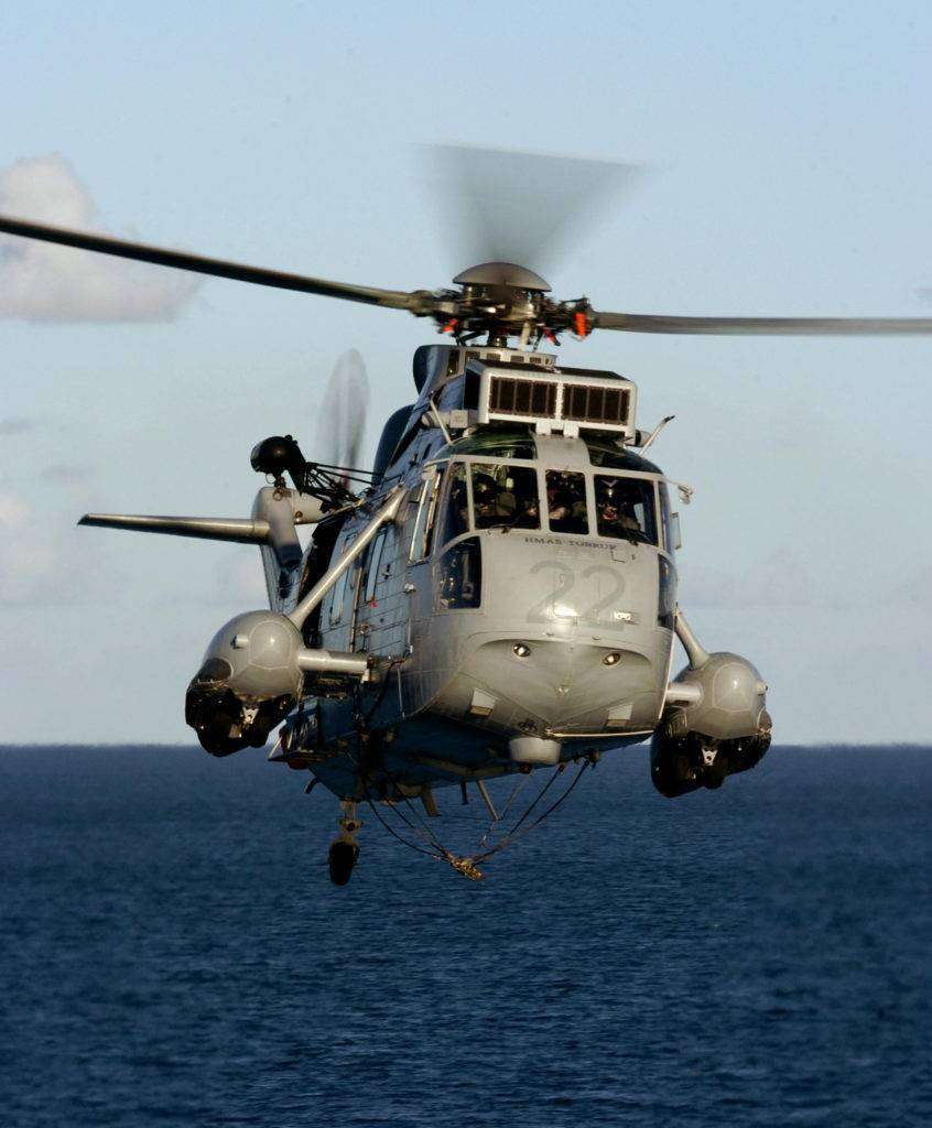 File No. RAN8109938_040310_327.JPG Date Taken: 20040310 Photographer: Able Seaman Yuri Ramsey Where: Townsville, QLD A Sea King Helicopeter approaching HMAS TOBRUK for VERTREP operations during EX SEA LION 04 More than 500 Royal Australian Navy, Army and Airforce personnel are on the move to Cowley Beach, north of townsville, to participate in the first of the Australian Defence Force's amphibious training exercises for the year, EXERCISE SEA LION. The three week long exercise which runs until 19 March 2004 is part of the ADF's ongoing efforts to improve it's amphibious capability for the defence of Australia. Exercise SEA LION will involve HMA Ships TOBRUK, LABUAN, BRUNEI and TARAKAN, elements from 3 Brigade, 10 Force Support Battalion and 5 Aviation Regiment. The exercise will focus on the planning and conduct of amphibious operations. It will exercise the different services of the ADF in working in a joint environment to develop and refine features for the ADF's amphibious capability. Exercise SEA LION will involve an amphibious work-up consisting mainly of embarkation and disembarkation procedures. The exercise will also involve planning and loading a variety of cargoes, activities to practice skills in the control of watercraft and helicopter drills and practice amphibious formations and procedures. Exercises such as this play a vital part in developing, maintaining and testing the readiness and sustainability of the ADF. The ADF is aware of the sensitive environment in which the exercise will take place and the exercise will be conducted within a strict environmental, safety and risk management constraints. A Sea King Helicopeter approaching HMAS TOBRUK for VERTREP operations during EX SEA LION 04
